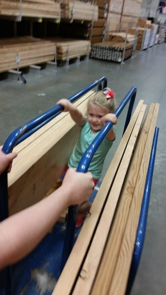 Time to buy the wood and Baby A is a big help at Lowe's of course.